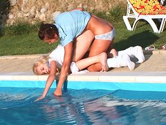 Two skinny young teens licking and fucking each other on a poolside