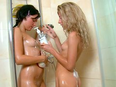 Two smokin hot young teens have a lesbian fun in shower