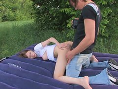 Teen couple has fun and pokes outdoors