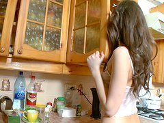 Young skinny girl is horny in her kitchen this morning
