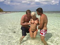 Busted blonde bitch is fucked on the beach by two cocks