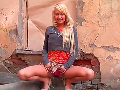 Amazing blonde likes to pose and tease