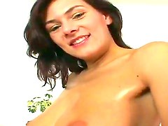 Young brunette Anita Quinn gets her oiled