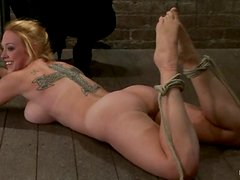 Busty blonde Isis Love enjoys being tied up and tortured