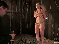 Bella Rossi gets chained and tormented by two men in a basement