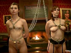Chained sex dolls are brought to be fucked hard