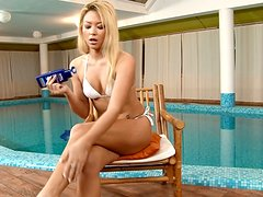 Natali moans crazily while fingering her vag on the poolside
