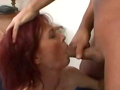 Redhead mom Maxine blows and enjoys multiposition sex