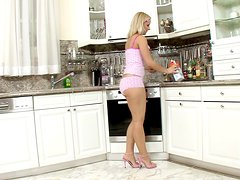 Naughty Cute Blonde Girl Playing with Herself in the Kitchen