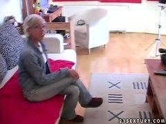 Kinky short-haired blonde Daniella toys her snatch before fisting it