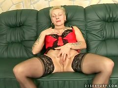 Tattooed blonde granny Nyikita takes a crazy ride on a hard cock