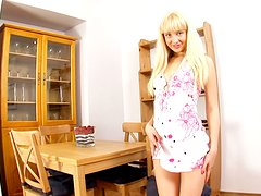 Kamilla enjoys fucking her asshole with a dildo in the kitchen