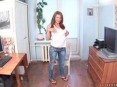 Lovely Megan sits on the floor and rides big dildo