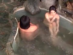 Japanese babe sucks a cock and gets fucked in a jacuzzi