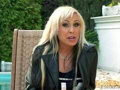 Adriana Russo the blonde MILF gives an interview