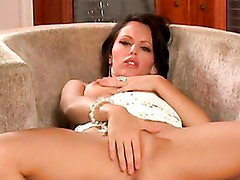 Lovely Jenna Presley tickles her pussy with her fingers on the couch
