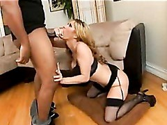 Sensual hottie Tiffany Mynx stuffs her mouth with a black shaft and enjoys it
