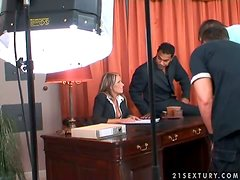 Blonde office chick has threesome sex in an office