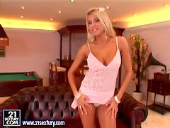 Slender blond angel is serving herself with a huge toy