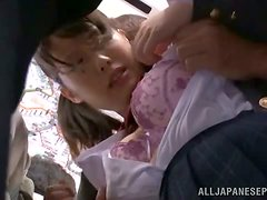 A cute schoolgirl on the bus gets groped and fingered