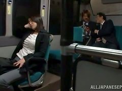An Asian broad is woken up by a guy fondling her