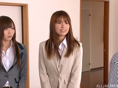 Two Japanese office girls satisfy some guy in the living room