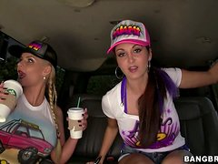 Two busty girls play with some lucky dude's cock in the bangbus