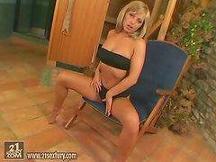 Dana the kinky blonde toys her hot pussy in a sauna