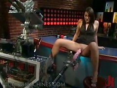 Stunning brunette babe get fucked by sex machine in the bar