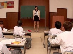 Several male students get busy with their teacher