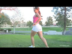 Sofia does exercises and shows her amenities in the yard