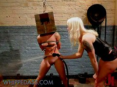Older woman mocks the younger girl in stunning dominatrix video