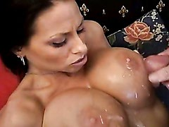 Harley Raines gets sprayed with a fresh load of cum on her big juggs