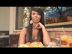 Naughty girl Rebecca shows her tits in a street cafe.