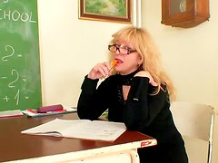 Mature teacher shows how to play