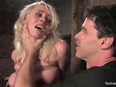 Sexy Blonde Works Up A Sweat In A Bondage Scene
