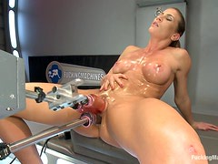Mature busty whore has sex with machine