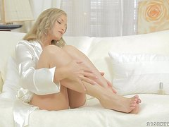Delightful blonde girl toys her smooth pussy with metal dildo