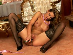 Glamorous brunette in sexy lingerie plays with her pussy
