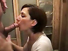 Redheaded wife talks dirty while giving BJ.