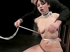 Cute asian girl is tied, gagged brought to orgasm