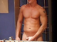 Ripped dude wanks in his bathroom