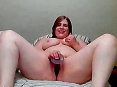 Young chubby girl masturbating on bed in front of cam