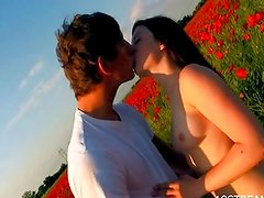Babe is fucked on a field
