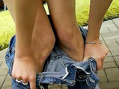 Simone plays with herself outdoors