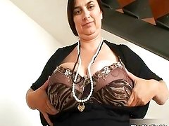 Busty mature whore gets horny showing