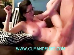 Busty girl reverse cowgirl on sofa
