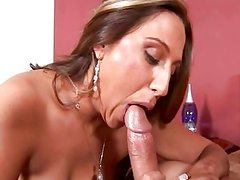 Brunette girl with big boobs giving blowjob