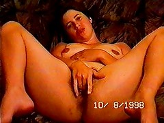 Amateur wife fingers her hairy cunt