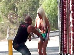 Blonds large breasts exposed on street